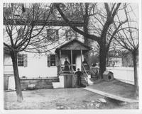 Thomas Moran, cooper, and family outside their house