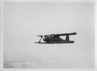 Beechcraft Model 17 Staggerwing biplane in flight