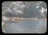 Children in boat on the pond in the gardens of Alice Lea Spruance at The Patch