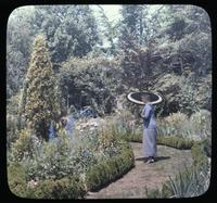 Mrs. Charles L. Patterson on path in her garden at Fair Hill Farm