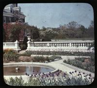 Formal gardens with fountain and tulips at Copeland House, home of Mr. and Mrs. Charles Copeland