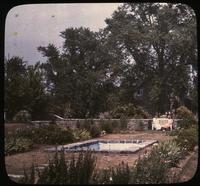 Mrs. Leroy Harvey and Mary sitting on bench in Terrace Garden near pond at Osborne Hill