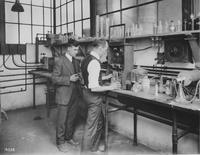 W.C. Murray, metallurgist, and W. Kuebler, Chief Chemist, in the foundry laboratory