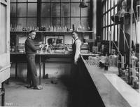 J.J. Gallagher and J. McDaniel, assistant chemists in the foundry laboratory