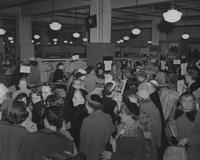 Shoppers at Everglaze fabric counters at Scruggs Vandervoort Barney Department Store (St. Louis, Mo.)