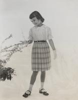 Young girl wearing blouse and skirt that is made with nylon