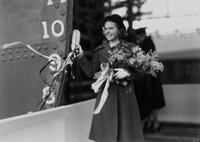 Sponsor Miss Betty Ann Jackson christening the cargo ship, S. S. Quaker
