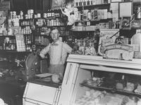 Harry Gallagher at the scales in his general store (Chadds Ford, Pa.)