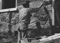 Stonemason at work on house for James Luke (Westover Hills, Del.)