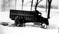 Chain drive Wawa Dairy Farm truck in the snow