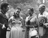 Irénée du Pont and his daughter, Mrs. Crawford H. Greenewalt, chatting with Eduard Franz and Sigrid Gurie