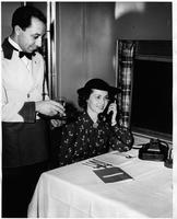 A passenger takes a call on the Pennsylvania Railroad Broadway Limited