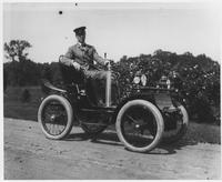 Alfred I. du Pont driving automobile