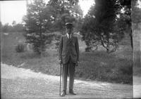 Unidentified older man with cane