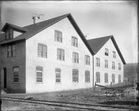 Mill buildings which were added on far side of railroad tracks