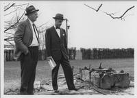 F.L. (Les) Mathewson and Norman B. Wilkinson visit site of former cannon house near Christ Church