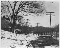 Main Street (Creek Road) after thaw and ice break-up in Henry Clay, Delaware