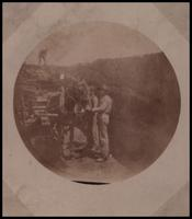 Workers with horse and cart at surface mine
