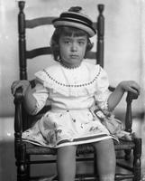 Unidentified child model, young girl wearing hat