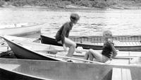 Two young girls in a canoe