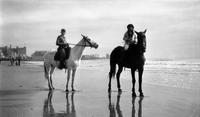 Elizabeth (Biz) Schoonover and another child riding horses on the beach