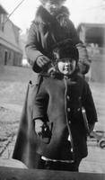 Child, possibly Cortlandt Schoonover, wearing coat and winter hat
