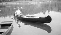 Frank Schoonover in canoe with fishing gear