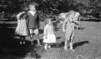 Group of children at Bushkill with cow in the background