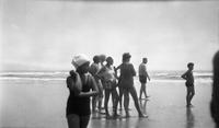 Group of young people on beach at Ventnor, New Jersey, or Rehoboth, Delaware