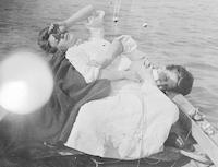 Phoebe Pyle and friend posing on boat