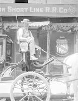 Carriage driver outside Oregon Short Line Railroad Co. building in Butte, Montana