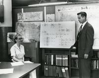 Grace Hopper and unidentified man with flow chart