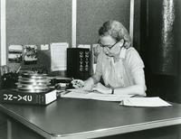 Grace Hopper seated at desk