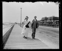 Cape May, man and woman walking on the boardwalk