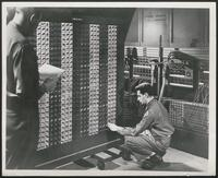 Maintenance engineers with ENIAC portable function table