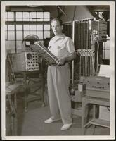 John W. Mauchly with ENIAC components