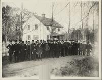 Men and boys standing in front of Old Yellow School House, Barley Mill Lane and Montchanin Road