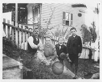 Albert Buchanan and family outside of home in Henry Clay Village