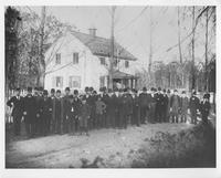 Men and children gathered in front of Old Yellow School House, Barley Mill Lane and Montchanin Road
