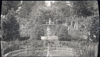 Fountain and roses in garden of Mrs. Charles L. Patterson at Fair Hill Farm