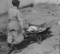 Street sweeper with wheelbarrow
