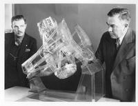 Captain Clyde S. McDowell with unidentified man and celluloid model of Hale Telescope
