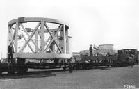 Revolving cage for tube assembly on rail cars for transportation from South Philadelphia Works