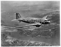 United Air Lines Mainliner (DC-3) in flight with one engine shut off over New York City