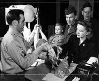 GI family life in Berlin-The Cumming family selects a turkey in the Army Commissary where each member of a family is allow $35 worth of food a month The allowance is sufficient, Behind the country is S/Sgt Frank Alfero