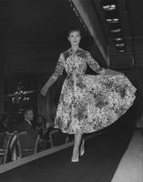 Collared floral day dress being modeled at Everglaze Fashion Show in London, England