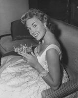 Marian McKnight, Miss America 1957, seated holding crown