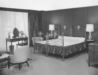 Everglaze chintz by Cyrus Clark in the sleeping area of bed-sitting room in William Pahlmann's 'Paris in New York' Exhibit
