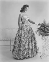Marian McKnight, Miss America 1957, in Everfast Everglaze polished cotton Dynascope print dress and overskirt by Jane Derby