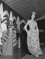Ceil Chapman evening dress being modeled at Zion's Co-operative Mercantile Institution (ZCMI) (Salt Lake City, Utah)